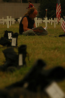 A demonstrator takes some down time at Arlington west, erected at the temporary Camp Casey in Washington DC, to signify the loss of more than 1900 U.S soldiers.