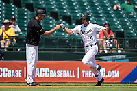 Stuart Fairchild (4) of the Wake Forest Demon Deacons bumps fists with head coach Tom Walter as he rounds third base after hitting his second solo home run of the game against the Miami Hurricanes in Game Nine of the 2017 ACC Baseball Championship at Louisville Slugger Field on May 26, 2017 in Louisville, Kentucky.  The Hurricanes defeated the Demon Deacons 5-2 to advance to the semi-finals.  (Brian Westerholt/Four Seam Images)
