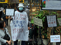 "Hong Kong investors demonstrate outside Citibank in Central District, Hong Kong. The demonstrators who lost much of their savings after Citi sold them financial products backed by Lehman denouncing Citi as a ""devil bank"" that ""swindled us out of our life savings.""."