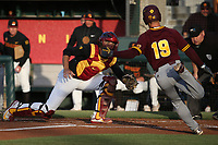 Cris Perez (29) of the Southern California Trojans reaches to tag out Jackson Willeford (19) of the Arizona State Sun Devils at home plate during a game at at Dedeaux Field on March 24, 2017 in Los Angeles, California. Southern California defeated Arizona State, 5-4. (Larry Goren/Four Seam Images)