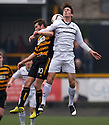Alloa's Graeme Holmes and Raith Rovers' Grant Anderson challenge for the ball.