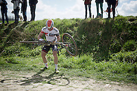 Vincente Reynes' (ESP/IAM) chain fell off on sector 21 and the fastest way to repair it was to simply 'do-it-yourself'<br /> <br /> 114th Paris-Roubaix 2016