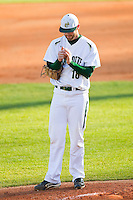 Starting pitcher Tyler Barnette (18) of the Charlotte 49ers rubs up the baseball during the game against the Delaware State Hornets at Robert and Mariam Hayes Stadium on February 15, 2013 in Charlotte, North Carolina.  The 49ers defeated the Hornets 13-7.  (Brian Westerholt/Four Seam Images)