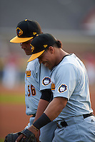 West Virginia Black Bears Carlos Munoz (56) and Deybi Garcia (5) during warmups before a game against the Batavia Muckdogs on August 31, 2015 at Dwyer Stadium in Batavia, New York.  Batavia defeated West Virginia 5-4.  (Mike Janes/Four Seam Images)