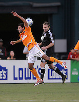 Houston Dynamo forward Dwayne De Rosario (14) goes up to head the ball against DC United defender Bryan Namoff (26)   ,The Houston Dynamo defeated DC United 3-1 to secure their place in  the SuperLiga semifinals, at RFK Stadium in Washington DC, Saturday July 19, 2008.