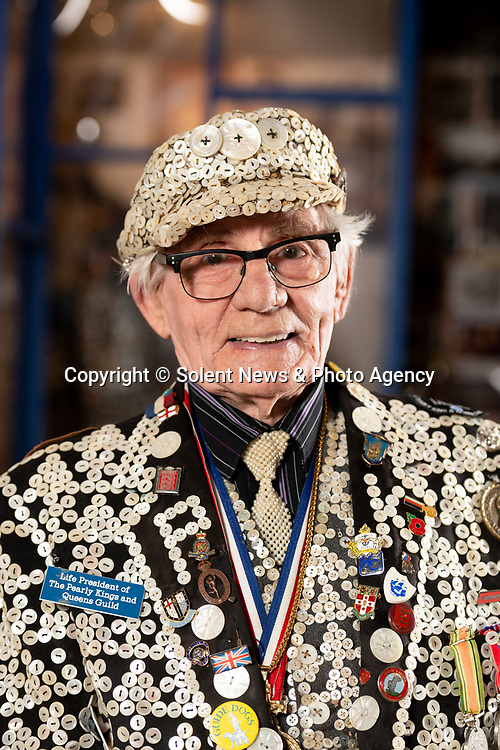 Pictured: Portrait of George Major inside The Cockney Museum in Stoneleigh, Surrey. <br /> <br /> Would you Adam and Eve it?  A pensioner spent his life savings opening the world's very first dedicated Cockney Museum - in Surrey.  Pearly King George Major has wanted to open a museum celebrating the old traditions of the East End of London since he was teenager.<br /> <br /> Now the 83-year old has finally achieved his dream but not in his birthplace of Peckham, but in the Home Counties, where he now lives.  Great grandfather George - who spent £60,000 on the project - said that 'Cockney London' is now 'basically dead' and claimed there are more Cockneys living in Surrey these days than there are in the capital.  SEE OUR COPY FOR DETAILS.<br /> <br /> © Jordan Pettitt/Solent News & Photo Agency<br /> UK +44 (0) 2380 458800
