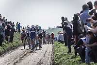 Niki Terpstra (NED/Quick Step Floors) leading the peloton over the cobbles of the first pavé sector. <br /> <br /> 116th Paris-Roubaix (1.UWT)<br /> 1 Day Race. Compiègne - Roubaix (257km)