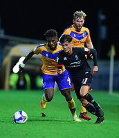 Lincoln City's Jamie Soule gets away from Mansfield Town's Rollin Menayese<br /> <br /> Photographer Andrew Vaughan/CameraSport<br /> <br /> EFL Trophy Northern Section Group E - Mansfield Town v Lincoln City - Tuesday 6th October 2020 - Field Mill - Mansfield  <br />  <br /> World Copyright © 2020 CameraSport. All rights reserved. 43 Linden Ave. Countesthorpe. Leicester. England. LE8 5PG - Tel: +44 (0) 116 277 4147 - admin@camerasport.com - www.camerasport.com