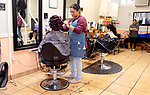 WATERBURY CT. - 27 December 2019-1227SV05-Arixsa Vargas, owner, works on a customer's hair at Maria's Hair Styling Salon on South Main Street in Waterbury Friday. <br /> Steven Valenti Republican-American