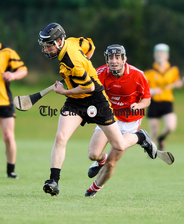 Clonlara's Nicky O Connell gets away from Crusheen's Patrick Vaughan during their championship game at Clarecastle. Photograph by John Kelly.