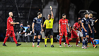 LAKE BUENA VISTA, FL - JULY 26: Referee Alex Chillowicz issues a yellow card to James Sands of New York City FC during a game between New York City FC and Toronto FC at ESPN Wide World of Sports on July 26, 2020 in Lake Buena Vista, Florida.