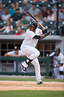 Engel Beltre (7) of the Charlotte Knights at bat against the Norfolk Tides at BB&T BallPark on April 9, 2015 in Charlotte, North Carolina.  The Knights defeated the Tides 6-3.   (Brian Westerholt/Four Seam Images)