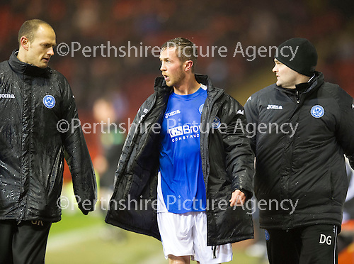 Aberdeen v St Johnstone..22.12.12      SPL.An injured Chris Millar leaves the pitch.Picture by Graeme Hart..Copyright Perthshire Picture Agency.Tel: 01738 623350  Mobile: 07990 594431