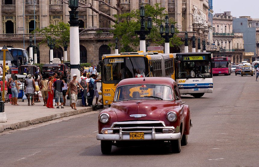 Classic American 50s Ford automobile driving streets of Havana Cuba Habana