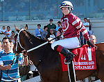 March 29, 2014: on Louisiana Derby Day at the Fairgrounds Race Course in New Orleans, LA. Mary M. Meek/ESW/CSM; Untapable winner's Circle photo with jockey Rosie Napravnik
