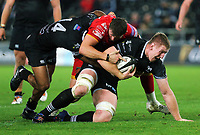 Bradley Davies of the Ospreys (R) is brought down during the Guinness PRO14 match between Ospreys and Dragons at The Liberty Stadium, Swansea, Wales, UK. Friday 27 October 2017
