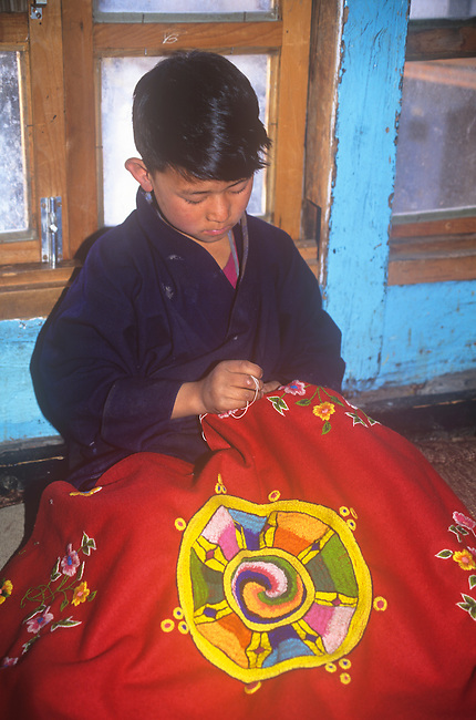 Child doing embroidering,Thimphu, Bhutan