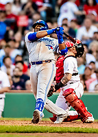 Jun 22, 2019; Boston, MA, USA; Toronto Blue Jays third baseman Vladimir Guerrero Jr. swings hard and narrowly misses hitting catcher Christian Vazquez in the 8th inning against the Boston Red Sox at Fenway Park. Mandatory Credit: Ed Wolfstein-USA TODAY Sports