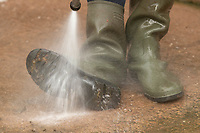 13-10-2021 Washing wellington boots after a farm visit <br />  ©Tim Scrivener Photographer 07850 303986<br />      ....Covering Agriculture In The UK....