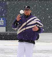 Brant Masters of the Furman Paladins makes a snowball after a game against the Northwestern Wildcats was stopped after five innings due to heavy snow on Saturday, February 16, 2013, in Greenville, South Carolina. After a 90-minute delay the game was cancelled. (Tom Priddy/Four Seam Images)