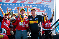 Sep 2, 2019; Clermont, IN, USA; NHRA top fuel driver Doug Kalitta (left) celebrates with his uncle and team owner Connie Kalitta after winning the US Nationals at Lucas Oil Raceway. Mandatory Credit: Mark J. Rebilas-USA TODAY Sports