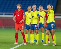 YOKOHAMA, JAPAN - AUGUST 6: Christine Sinclair #12 of Canada stands in the box during a game between Canada and Sweden at International Stadium Yokohama on August 6, 2021 in Yokohama, Japan.