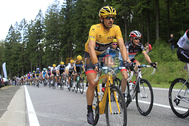 The peloton led by the Radioshack-Nissan team including Yellow Jersey race leader Fabian Cancellara (SUI) climbs the Cote de Francorchamps during Stage 1 of the 99th edition of the Tour de France, running 198km from Liege to Seraing, Belgium. 1st July 2012.<br /> (Photo by Eoin Clarke/NEWSFILE)