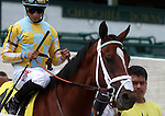 June 21, 2014:  Shown here in the post parade, Unbridled Reward and jockey Alan Garcia go on to finish second in the Debutante Stakes (6f, 2yo fillies) at Churchill Downs. Owner John Oxley, trainer Mark Casse. ©Mary M. Meek/ESW/CSM