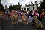 Hundreds of people stage a rally to commemorate the Columbus Day on the main Mexico City's thoroughfare, October 12, 2019. Members of the National Indigenous Congress-Council of Indigenous Government protested against megaprojects in Mexico's 17 states as they demand to be respected in their autonomies and self-governments. Photo by Heriberto Rodriguez