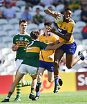 Chibby Okoye of Clare in action against Conor Flannery of Kerry during their Munster Minor football final at Pairc Ui Chaoimh. Photograph by John Kelly.