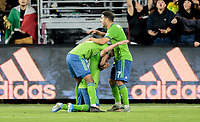 LOS ANGELES, CA - OCTOBER 29: Nicolas Lodeiro #10 of the Seattle Sounders FC scores a goal and celebrates with teammate Cristian Roldan #7 during a game between Seattle Sounders FC and Los Angeles FC at Banc of California Stadium on October 29, 2019 in Los Angeles, California.