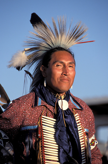 Assiniboine Sioux tribal member from Fort Peck Montana is Greg Red Elk dressed in his traditional outfit of a ribbon shirt, hairpipe bone chest plate and eagle feather with porcupine roach headdress ?
