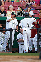 Kane County Cougars third baseman Henry Castillo (4) gets congratulations from coach Doug Bochtler (45) after hitting a home run during a game against the Great Lakes Loons on August 13, 2015 at Fifth Third Bank Ballpark in Geneva, Illinois.  Great Lakes defeated Kane County 7-3.  (Mike Janes/Four Seam Images)