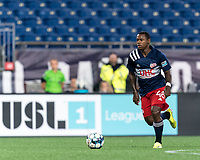 FOXBOROUGH, MA - SEPTEMBER 1: Michel #48 of New England Revolution II dribbles during a game between FC Tucson and New England Revolution II at Gillette Stadium on September 1, 2021 in Foxborough, Massachusetts.