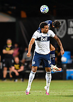 LAKE BUENA VISTA, FL - JULY 26: Theo Bair of Vancouver Whitecaps FC and Roberto Puncec of Sporting KC challenge for a header during a game between Vancouver Whitecaps and Sporting Kansas City at ESPN Wide World of Sports on July 26, 2020 in Lake Buena Vista, Florida.