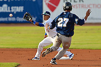 Jesmuel Valentin (6) of the Ogden Raptors fields the throw as Helena Brewers right fielder Dionis Hinojosa (27) slides into second base in action at Lindquist Field on July 23, 2013 in Ogden Utah. (Stephen Smith/Four Seam Images)
