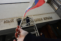 """After 2 hours since the signing of the Russian-Crimean treaty the letters on the entrance of the Crimean parliament """"Parliament of autonomous republic of Crimea"""" are being removed and coat-of-arms is being replaced. Simferopol, Crimea. March 19, 2014"""