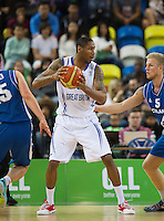 20 AUG 2014 - LONDON, GBR - Drew Sullivan (GBR) (centre in white) from Great Britain looks for a path through the Iceland defence during thir men's 2015 EuroBasket 3rd Qualifying Round game at the Copper Box Arena in the Queen Elizabeth Olympic Park in Stratford, London, Great Britain (PHOTO COPYRIGHT © 2014 NIGEL FARROW, ALL RIGHTS RESERVED)