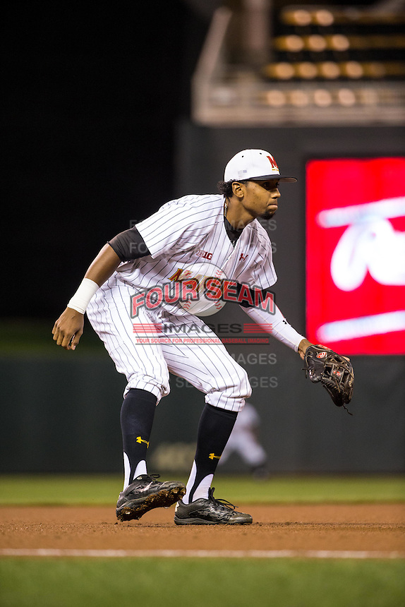 Jose Cuas (12) of the Maryland Terrapins fields during a 2015 Big Ten Conference Tournament game between the Maryland Terrapins and Michigan State Spartans at Target Field on May 20, 2015 in Minneapolis, Minnesota. (Brace Hemmelgarn/Four Seam Images)