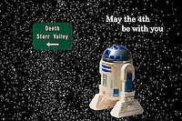 Recognizing Star Wars Day with a composite of a Nevada road sign, a toy R2D2 and a starscape captured on a starry night in Oregon.