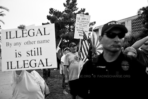 Phoenix, Arizona,<br /> USA <br /> June 2010 <br /> <br /> Pro SB 1070 supporters argue with a anti SB 1070 members at a rally on the Arizona State Capitol grounds during a public rally held in favor of Arizona's controversial Senate Bill, 1070 aimed at illegal immigration, Phoenix, Arizona, USA, on 31 July 2010. The state's controversial law went into effect at 12 01 am on 29 July but with a limited effect as Judge Susan Bolton put a injunction on the most controversial parts that many people say was unconstitutional and based on racial profiling.