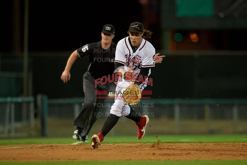Richmond Flying Squirrels third baseman Jonah Arenado (26) fields a ground ball in front of umpire Thomas Roche during an Eastern League game against the Binghamton Rumble Ponies on May 29, 2019 at The Diamond in Richmond, Virginia.  Binghamton defeated Richmond 9-5 in ten innings.  (Mike Janes/Four Seam Images)