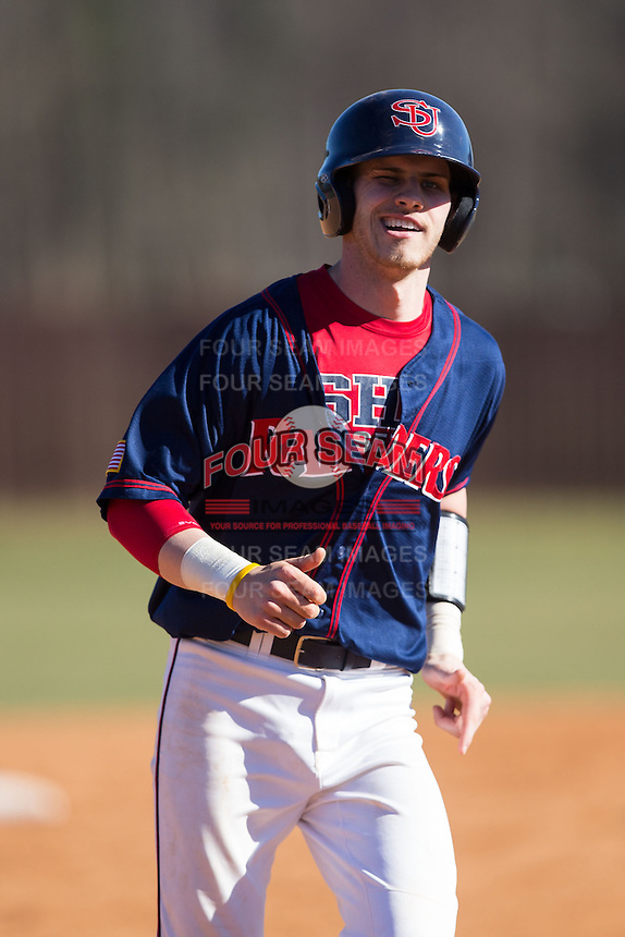 Jake Kennedy (30) of the Shippensburg Raiders winks at his third base coach as he rounds the bases following his second home run of the game against the Belmont Abbey Crusaders at Abbey Yard on February 8, 2015 in Belmont, North Carolina.  The Raiders defeated the Crusaders 14-0.  (Brian Westerholt/Four Seam Images)