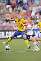 Sara Larsson #7, Amy Rodriguez...USWNT tied Sweden 1-1 at Morrison Stadium, Omaha Nebraska.