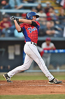 Asheville Tourists third baseman Ryan McMahon #5 swings at a pitch during a game against the Lakewood BlueClaws at McCormick Field on May 2, 2014 in Asheville, North Carolina. The Tourists defeated the BlueClaws 14-3. (Tony Farlow/Four Seam Images)