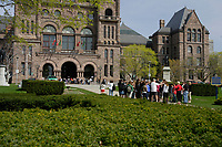 Toronto (ON) CANADA,  April , 2008-<br /> A group of tourists approach TheOntario Legislature in Queens Park.<br /> <br /> urban park in the Downtown area of Toronto. Opened in 1860 by Edward, Prince of Wales, it was named in honour of Queen Victoria. The park is the site of the Ontario Legislature, which houses the Legislative Assembly of Ontario, and so the phrase Queen's Park is also frequently used to refer to the Government of Ontario.