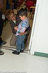 Preschool 2-3 year olds female teacher talking to sad boy at beginning of school day
