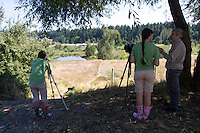 Olivia Peterson from Edmonds, Wash. (left) who just graduated from Meadowdale H.S. and Theresa Keith, a recent graduate from Holy Names Academy watch Western Pond Turtles through a telescope in Lakewood, Wash.  Both are interns with Zoo Corps and helped take care of the trutles at the Woodland Park Zoo.  Together with the Washington Department of Fish and Wildlife (WDFW) over 100 of the endangered turtles were released back into their native habitat.