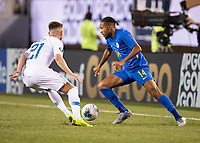 PHILADELPHIA, PA - JUNE 30: Tyler Boyd #21 defends against Kenji Gorre #14 during a game between Curaçao and USMNT at Lincoln Financial Field on June 30, 2019 in Philadelphia, Pennsylvania.