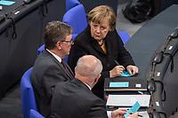 7. Sitzung des Deutschen Bundestag am Donnerstag den 18. Januar 2018.<br /> Im Bild: Bundeskanzlerin Angela Merkel im Gespraech mit Michael Grosse-Broemer, CDU, Erster Parlamentarischer Geschaeftsfuehrer der CDU/CSU-Fraktion (links) und Volker Kauder, CDU, Vorsitzender der CDU/CSU-Bundestagsfraktion (Ruecken).<br /> 18.1.2018, Berlin<br /> Copyright: Christian-Ditsch.de<br /> [Inhaltsveraendernde Manipulation des Fotos nur nach ausdruecklicher Genehmigung des Fotografen. Vereinbarungen ueber Abtretung von Persoenlichkeitsrechten/Model Release der abgebildeten Person/Personen liegen nicht vor. NO MODEL RELEASE! Nur fuer Redaktionelle Zwecke. Don't publish without copyright Christian-Ditsch.de, Veroeffentlichung nur mit Fotografennennung, sowie gegen Honorar, MwSt. und Beleg. Konto: I N G - D i B a, IBAN DE58500105175400192269, BIC INGDDEFFXXX, Kontakt: post@christian-ditsch.de<br /> Bei der Bearbeitung der Dateiinformationen darf die Urheberkennzeichnung in den EXIF- und  IPTC-Daten nicht entfernt werden, diese sind in digitalen Medien nach §95c UrhG rechtlich geschuetzt. Der Urhebervermerk wird gemaess §13 UrhG verlangt.]